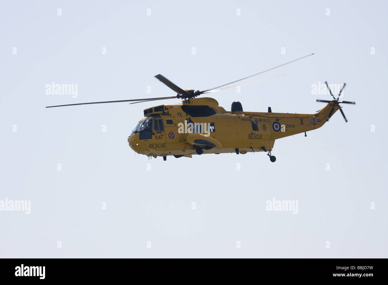 raf yellow search and rescue helicopter flying blades southend airshow england uk europe - Stock Image