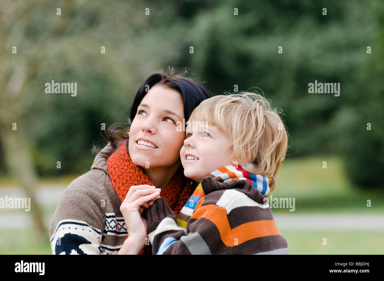 Young woman and boy looking upward, Vancouver, British Columbia - Stock Image
