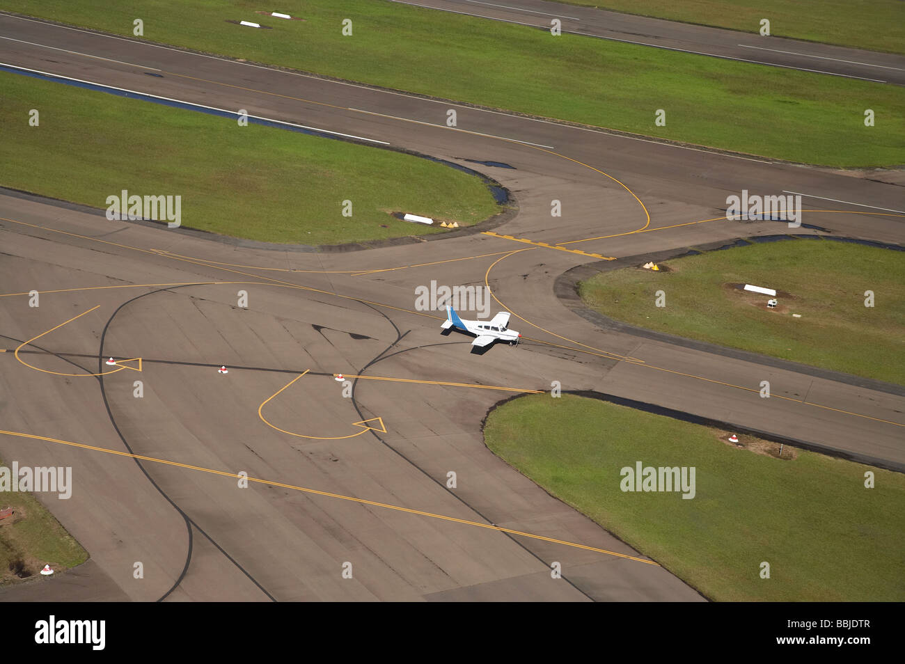 Light Plane on Runway Bankstown Airport Sydney New South Wales Australia aerial - Stock Image