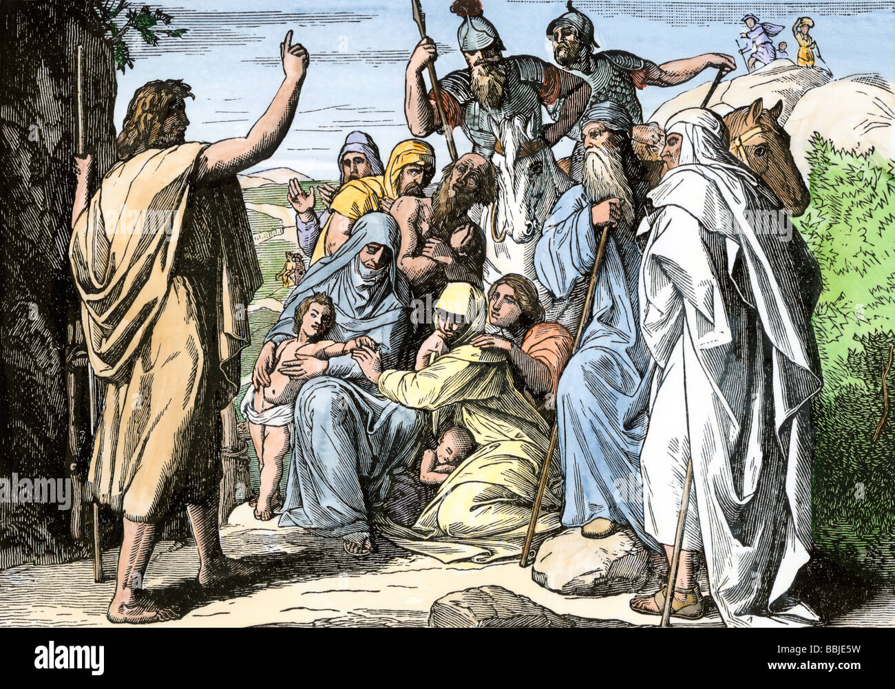John the Baptist foretelling the coming of a messiah. Hand-colored woodcut - Stock Image