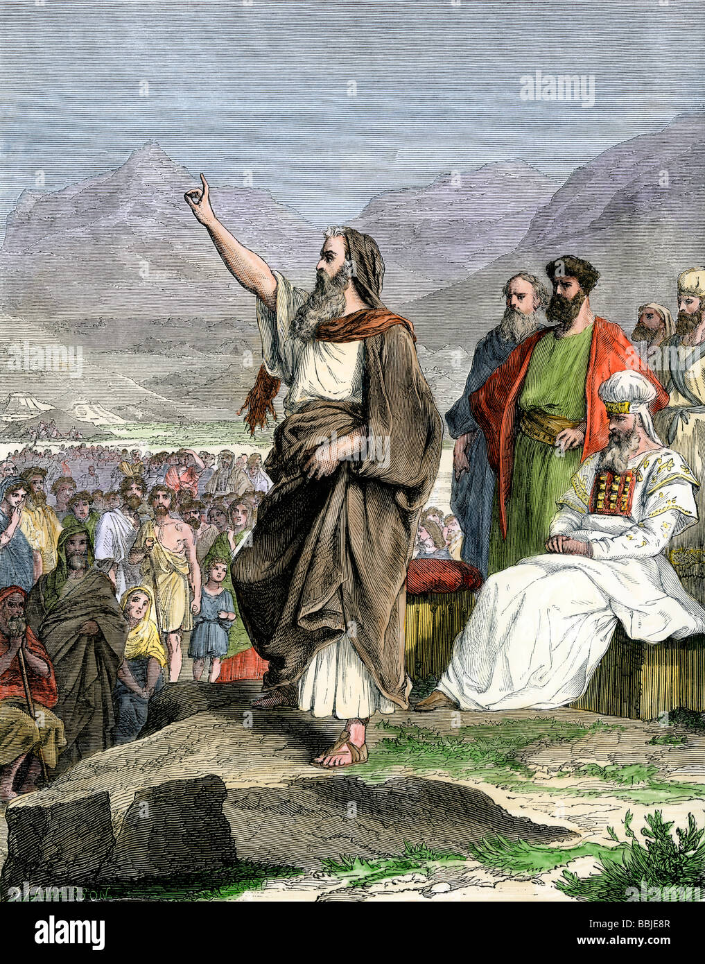 adcd5576632c Moses giving the laws to the Hebrew people during the Exodus. Hand-colored  woodcut