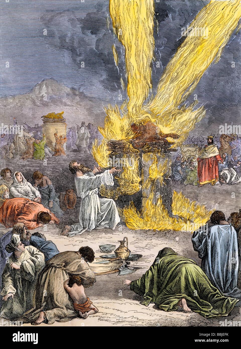 Prophet Elijah invoking Yahweh over Baals priests on Mount Carmel. Hand-colored woodcut - Stock Image