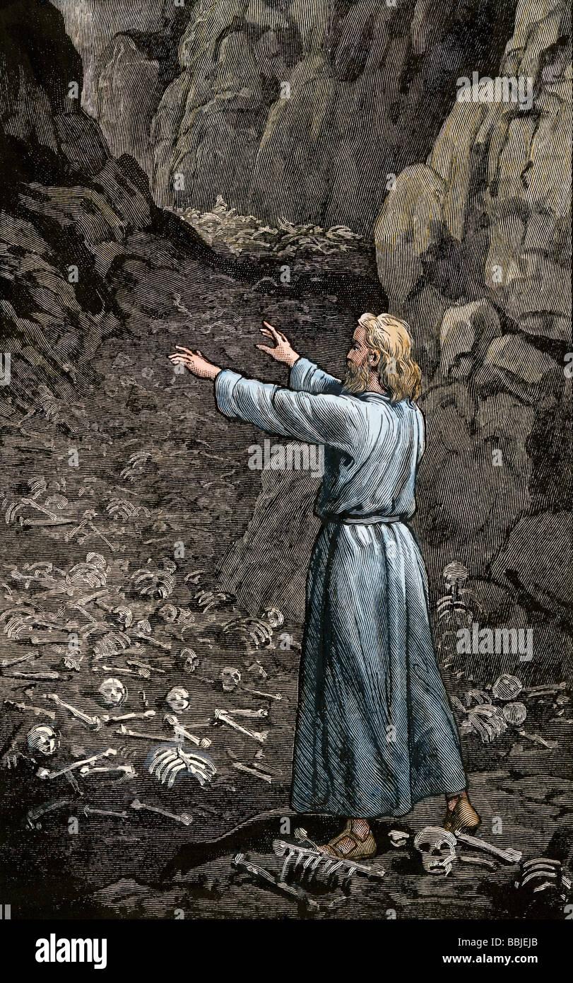 Hebrew prophet Ezekiel walking through the valley of dry bones. Hand-colored woodcut - Stock Image