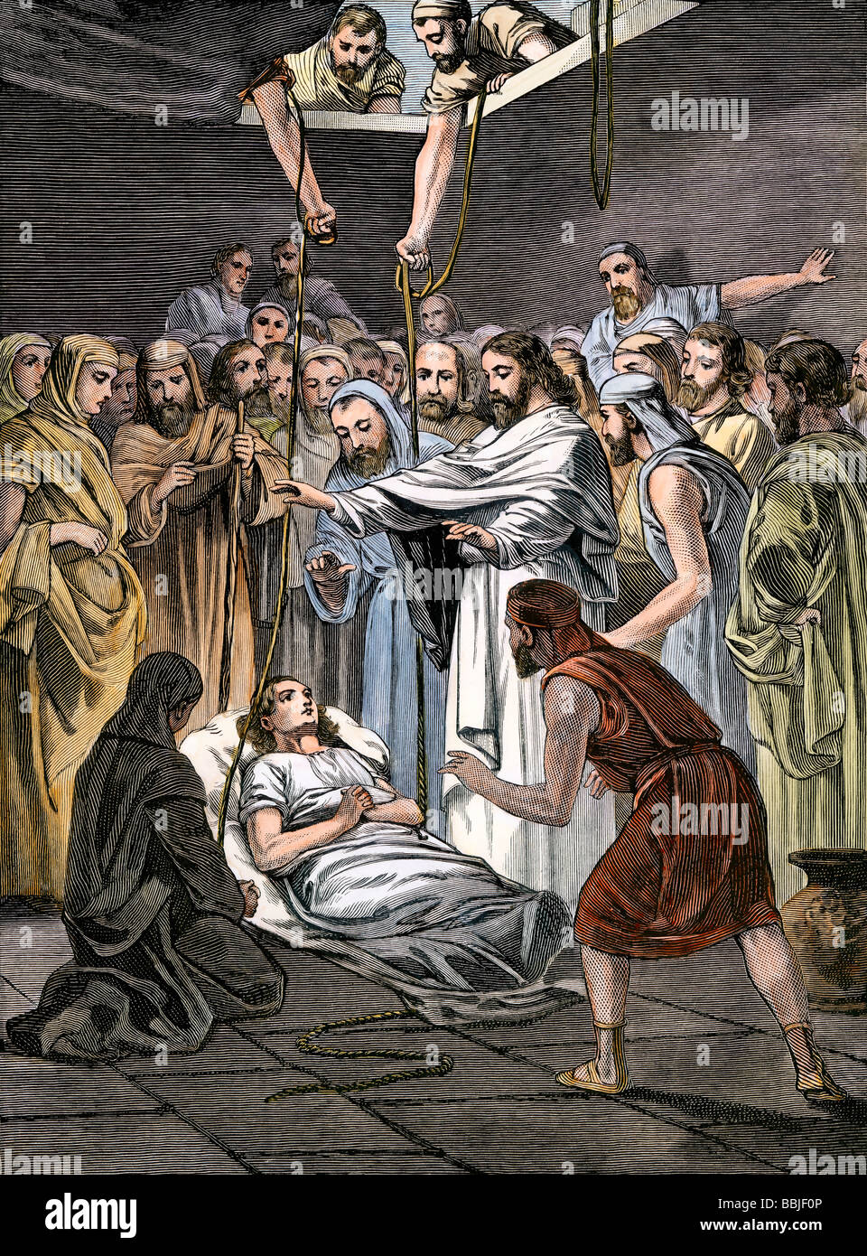 Jesus raising Lazarus from his tomb. Hand-colored woodcut - Stock Image