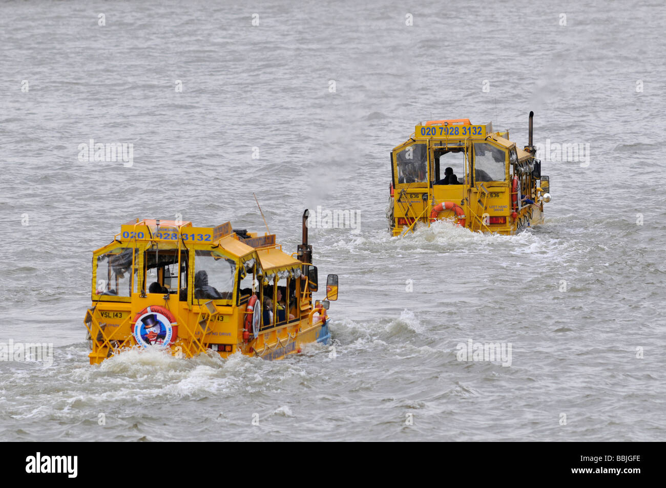 Amphibious vehicles, known as Duck tours, used as tourist attraction around Westminster and on the river Thames - Stock Image