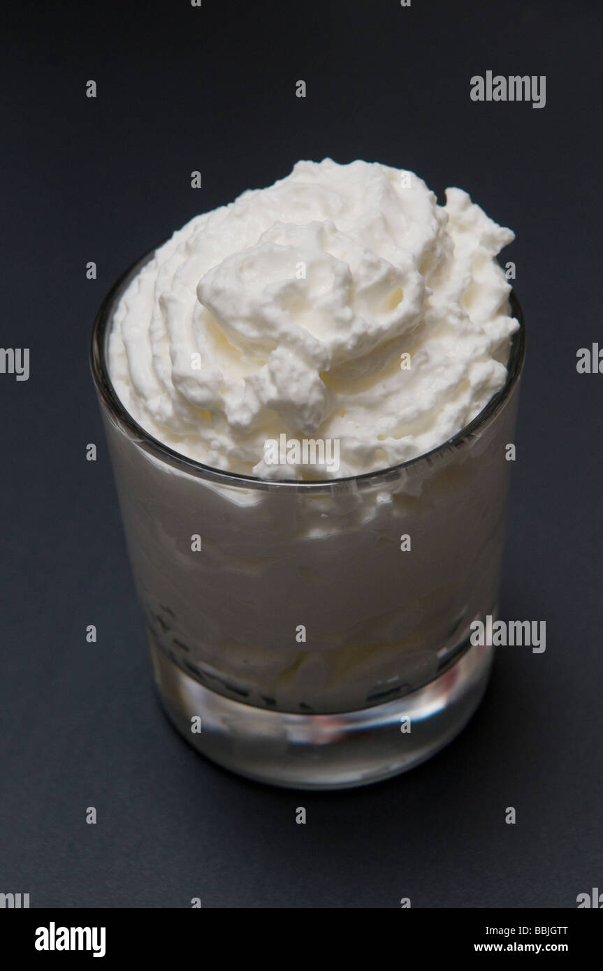 Whipped cream in a glass - Stock Image