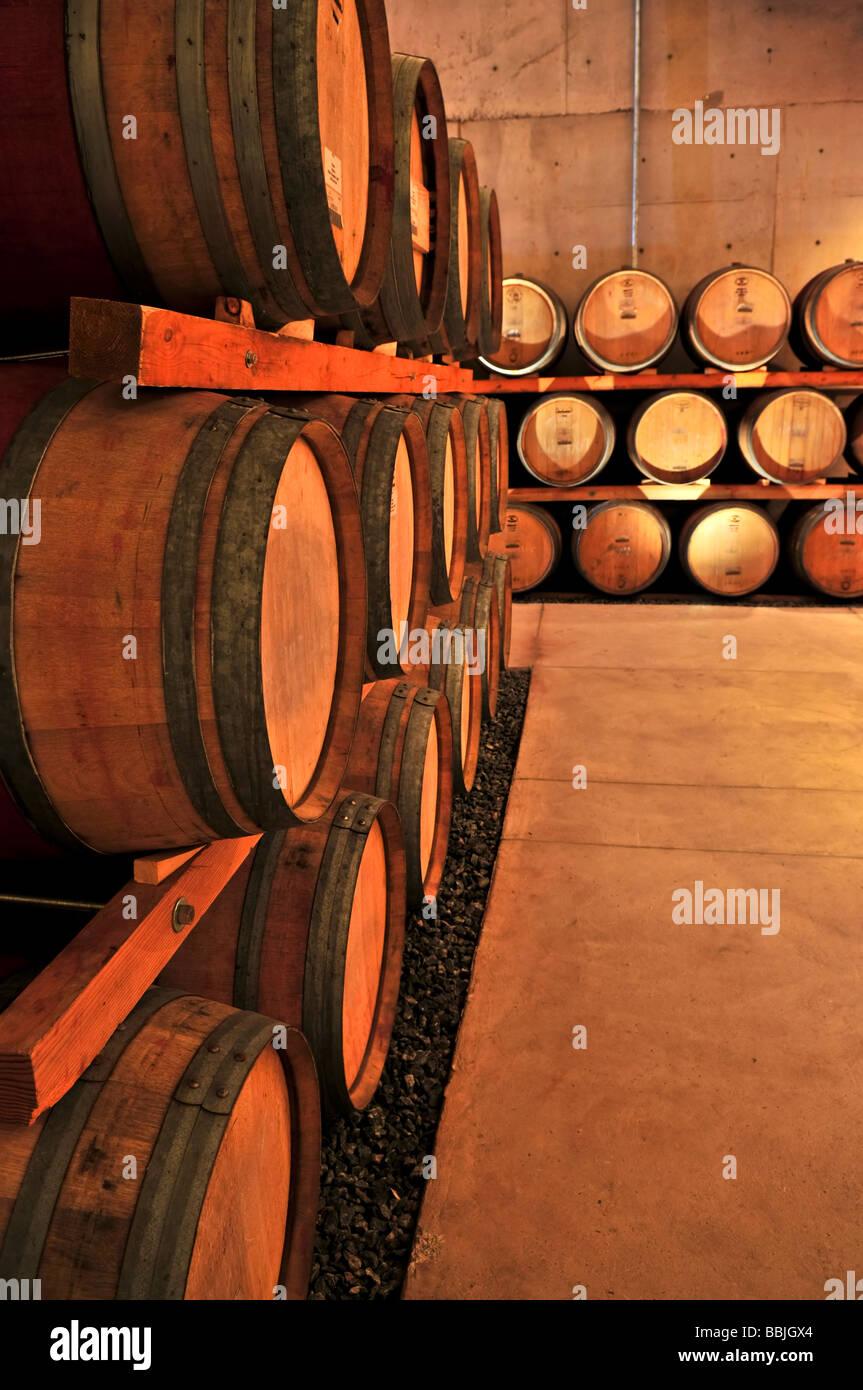 stacked oak barrels. Stacked Oak Wine Barrels In Winery Cellar