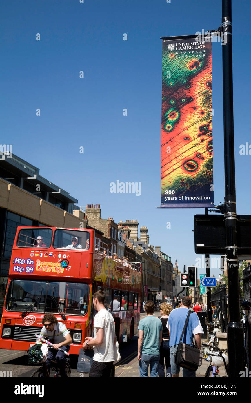 A tourist bus and colourful signs for the 800th anniversary of Cambridge University along the roads in Cambridge, - Stock Image