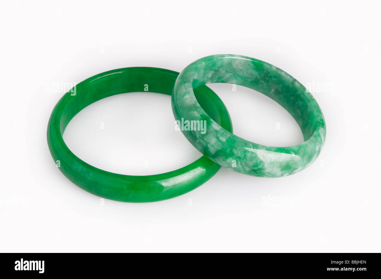 Imperial Jade, 'jadeite' bangles on white background - Stock Image