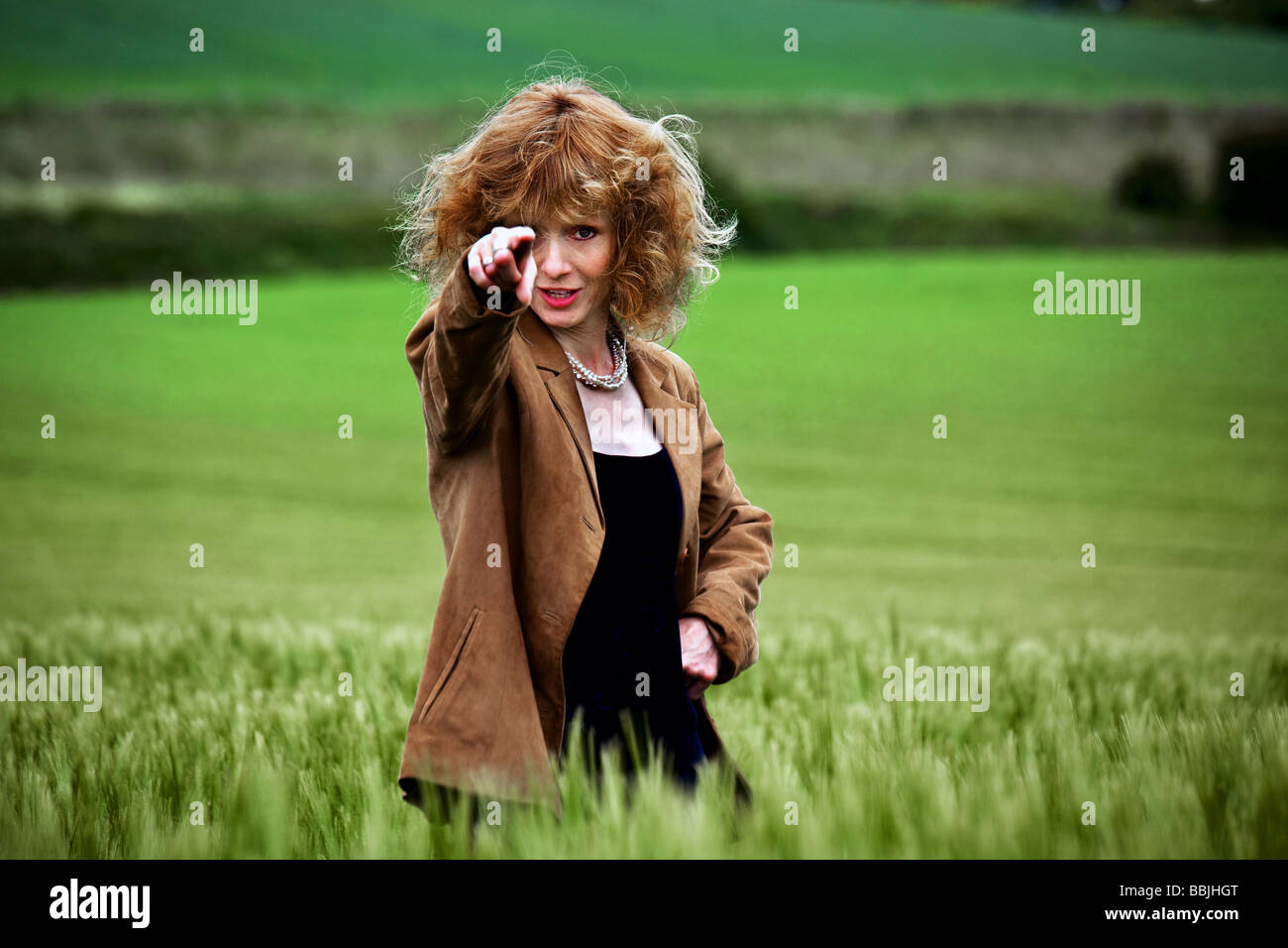 A girl in a field of barley Stock Photo