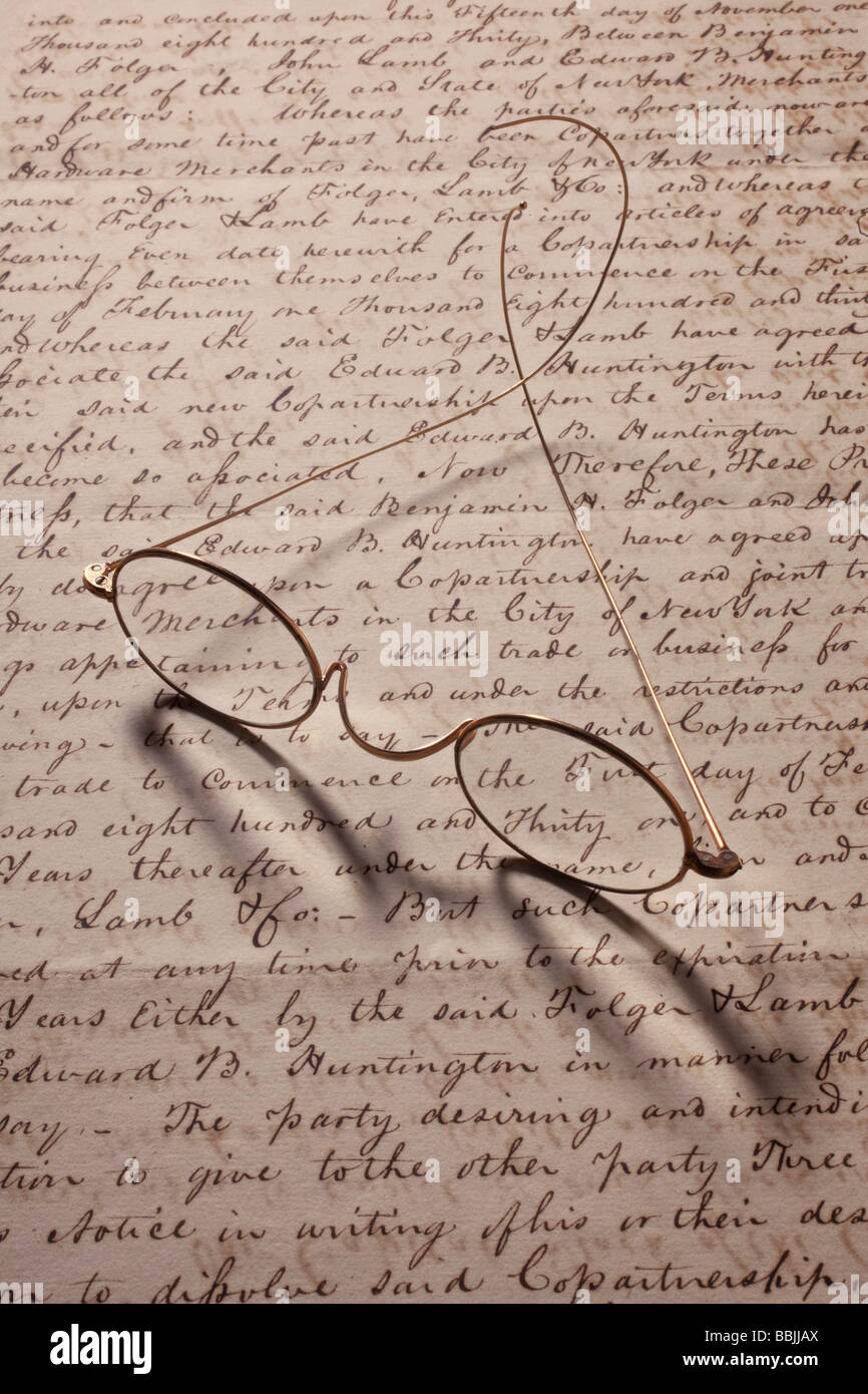 Old glasses on old letter - Stock Image