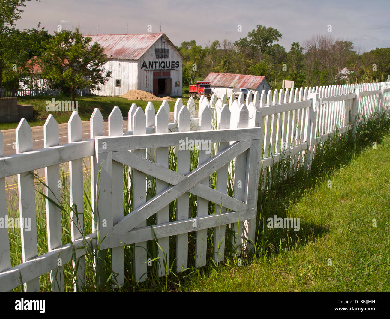 Antique store on US Highway 12 Brooklyn Michigan and pickett fence Walker Tavern Historic Site - Stock Image