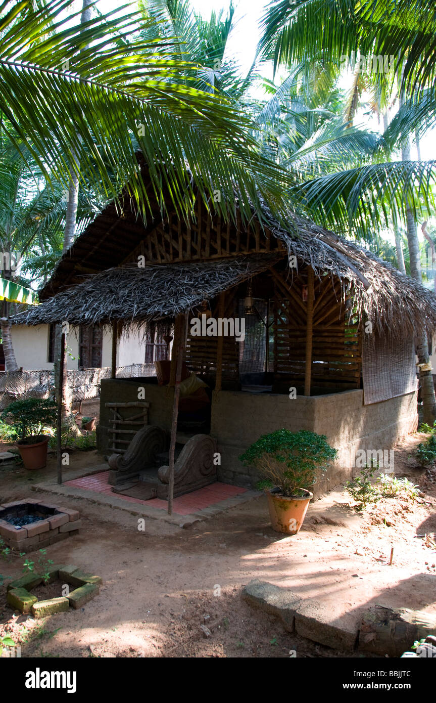 Local thatch roofed house in kerala, India - Stock Image