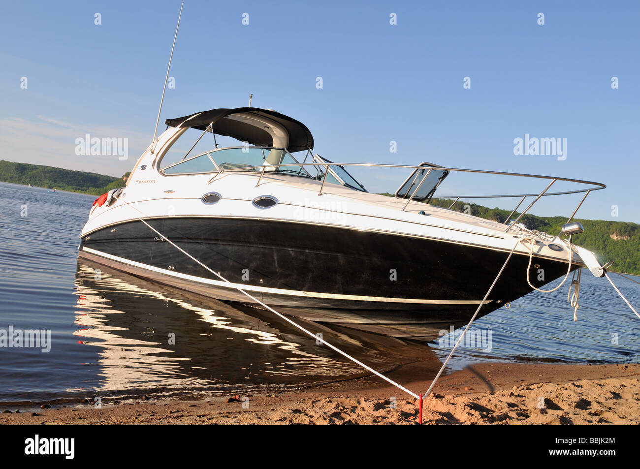 Anchored boat side view. - Stock Image