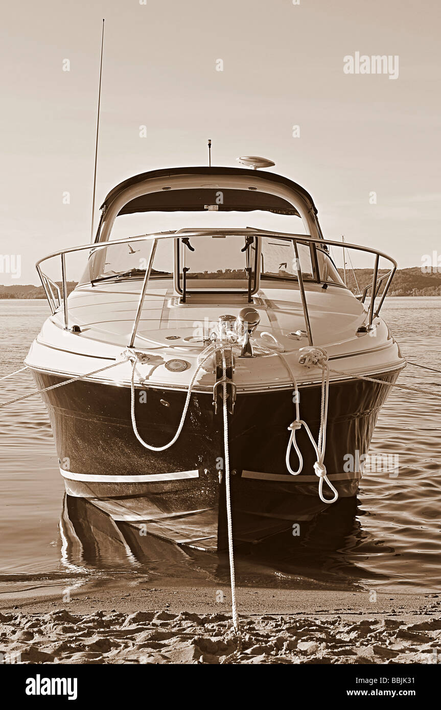 Anchored boat - sepia. - Stock Image