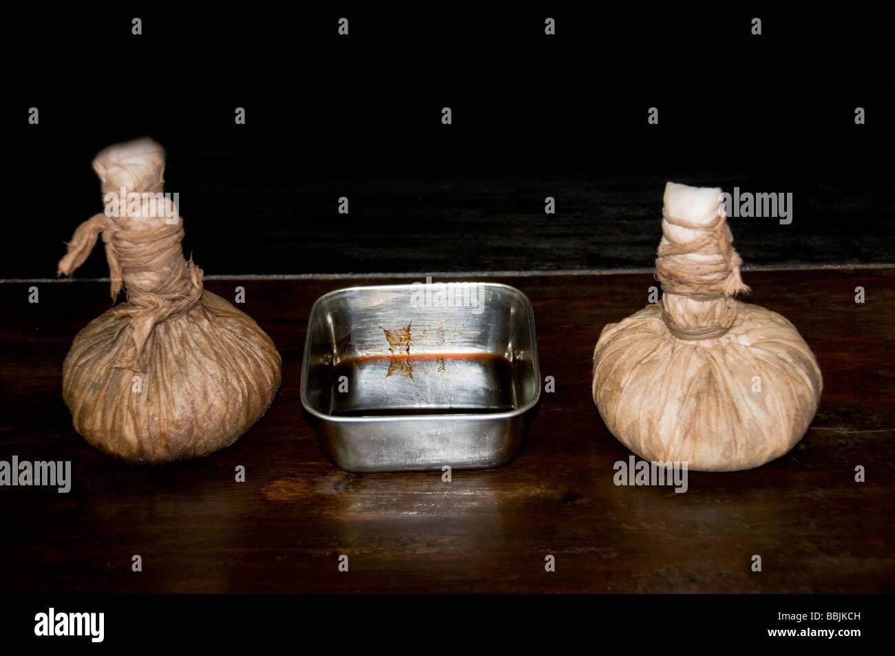 herbal bags or Kizhi used for ayurveda massage, ayurvedic treatment, kerala India - Stock Image