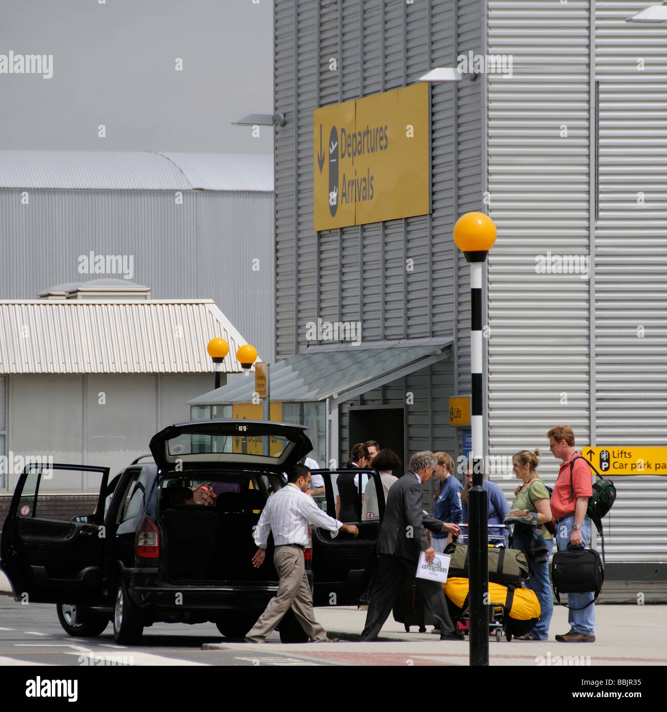 Meet And Greet Travellers Being Picked Up At Terminal 4 London Stock