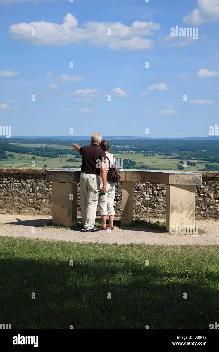 Tourists at the table of orientation on the terrace at Vezelay, Burgundy, France. - Stock Image