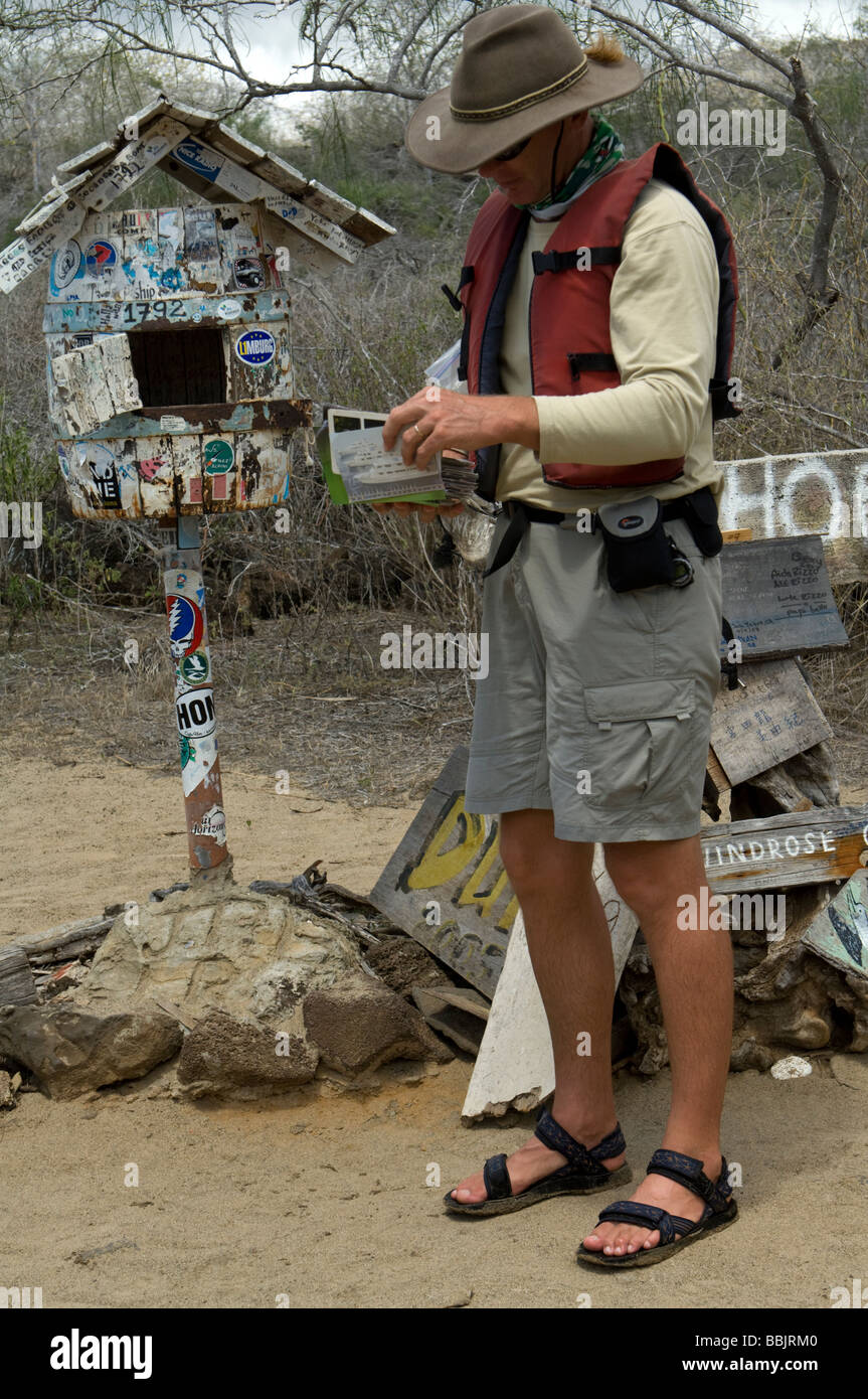 Daniel Fitter Nature Guide And Author Check The Post At Office Bay Floreana Galapagos Ecuador Pacific Ocean South America