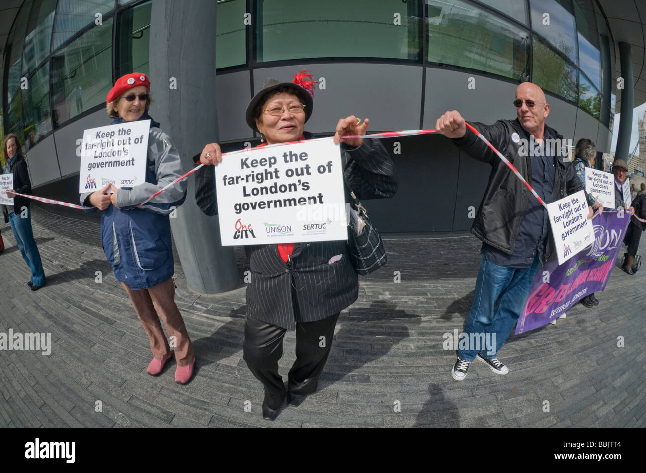 Londoners opposed to election of a BNP London Assembly member form a 'RIng of Democracy' around City Hall. - Stock Image