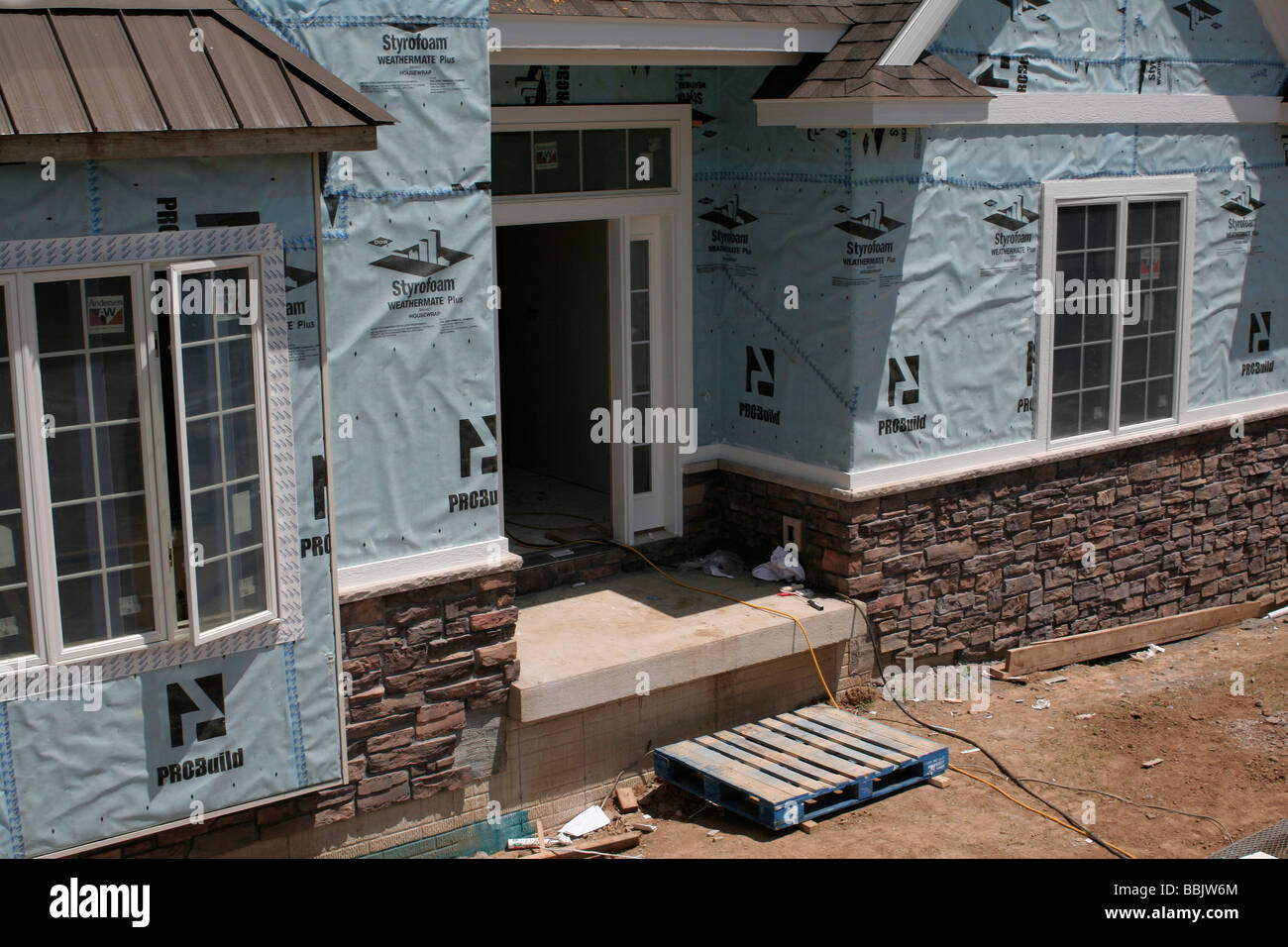 New Home Construction Using House Wrap Stock Photo Alamy