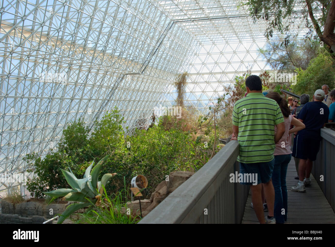 USA Arizona Oracle Biosphere 2 Ocean biome visitors listen to guide habitat living quarters and glass enclosed environments - Stock Image