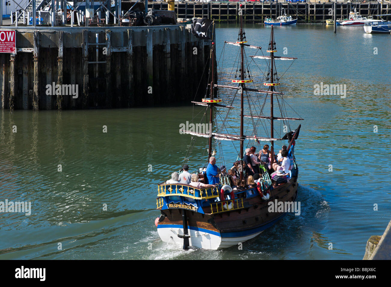 Excursion boat returning to the harbour, Scarborough, East Coast, North Yorkshire, England - Stock Image