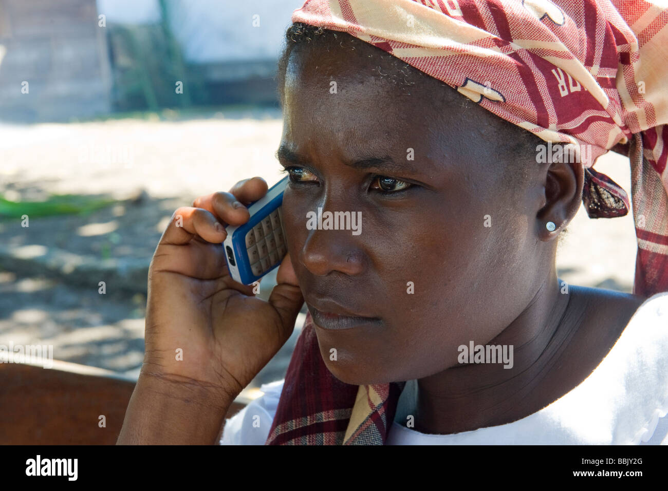 African woman using her moblie phone Quelimane Mozambique - Stock Image