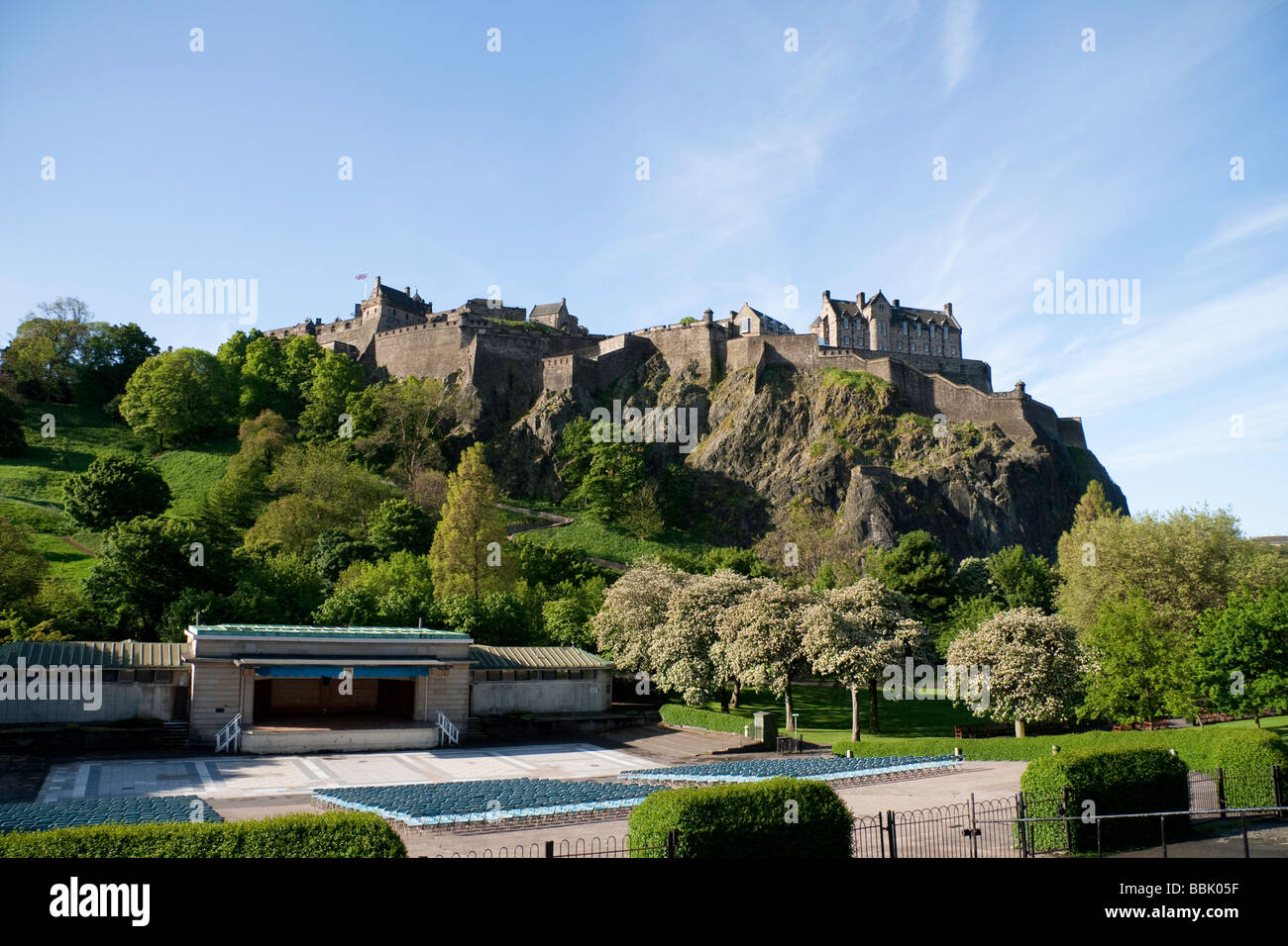Edinburgh Castle and the Ross Bandstand in Princes Street Gardens on a summer's day - Stock Image