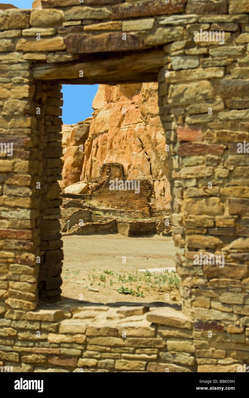 USA New Mexico Chaco Culture National Historical Park Pueblo Bonito remaining walls thru window Stock Photo