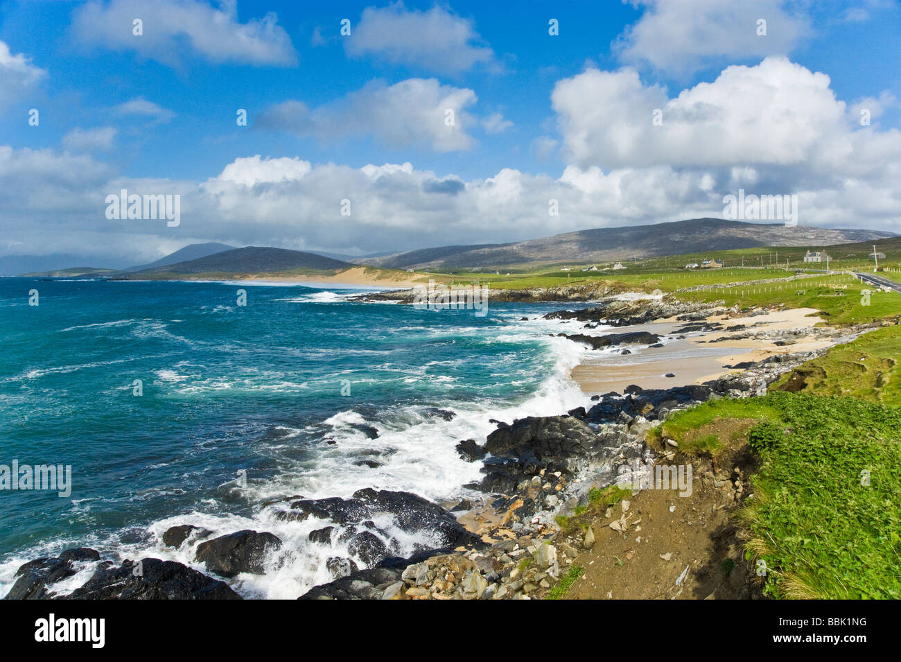 Sandy beaches and waves breaking on the west coast of South Harris near near Sgarasta Mhor South  on the Outer Hebrides - Stock Image