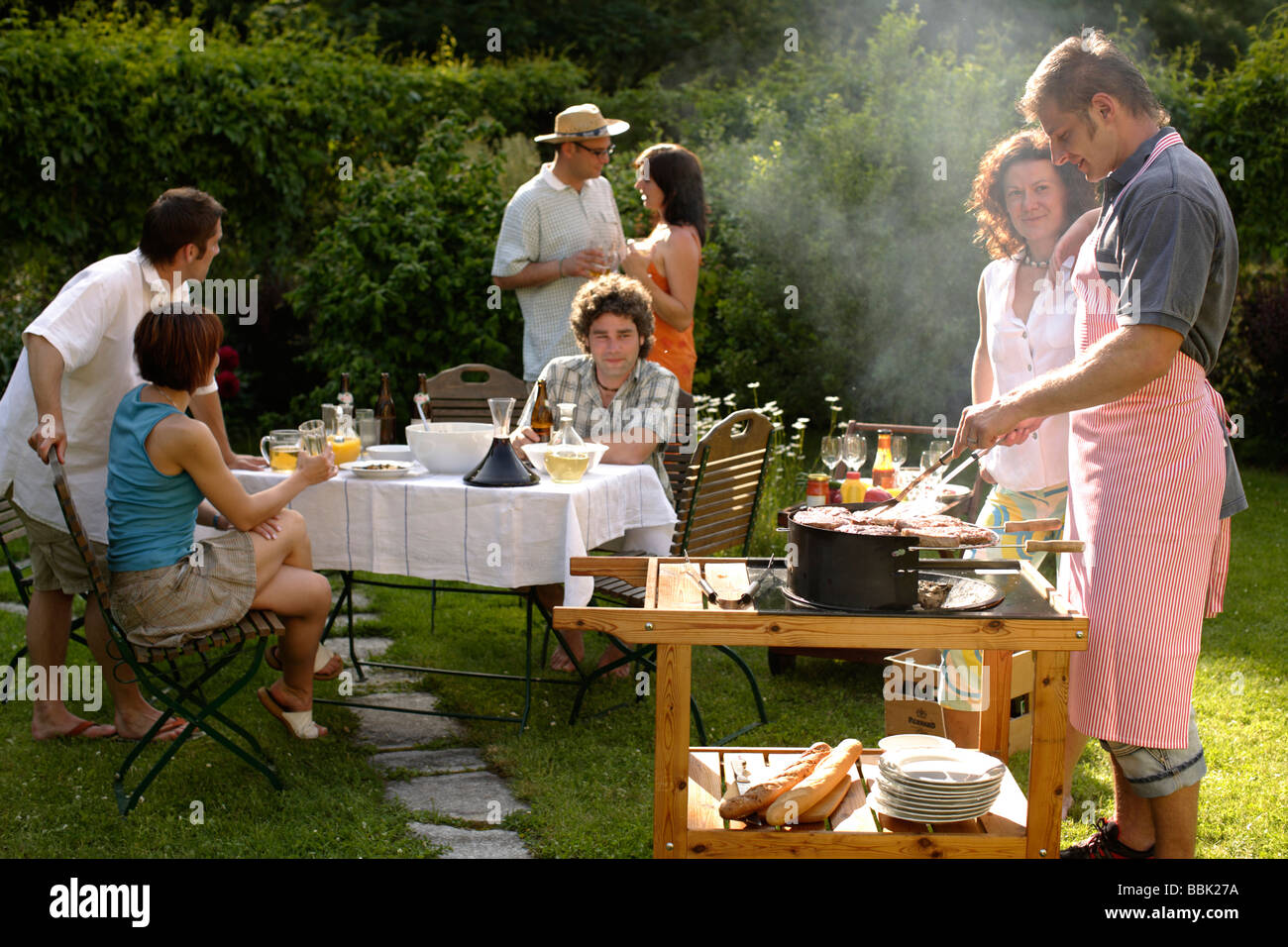 barbecue party garden party grill party stock photo 24390446 alamy. Black Bedroom Furniture Sets. Home Design Ideas
