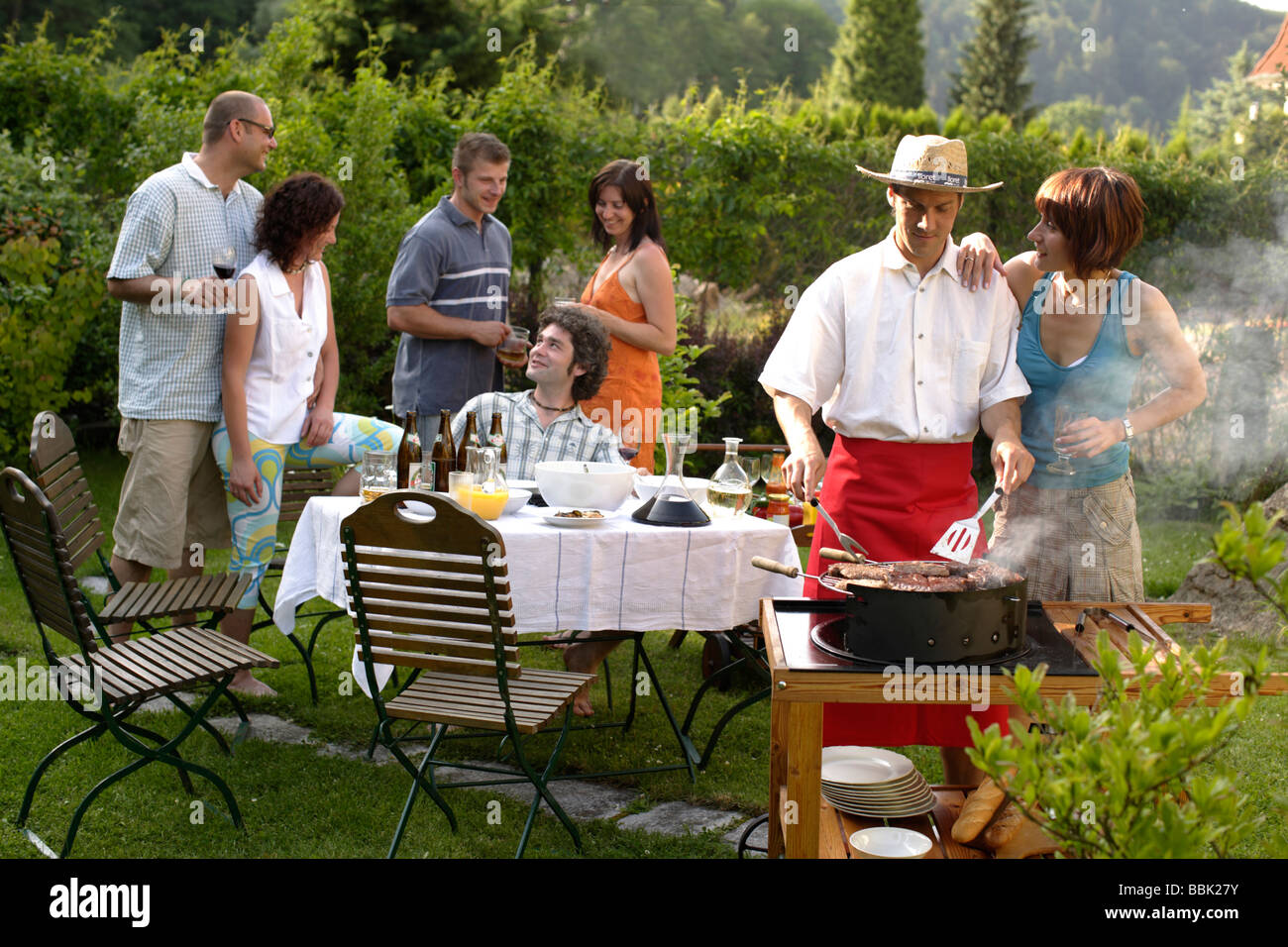 barbecue party garden party grill party stock photo 24390463 alamy. Black Bedroom Furniture Sets. Home Design Ideas