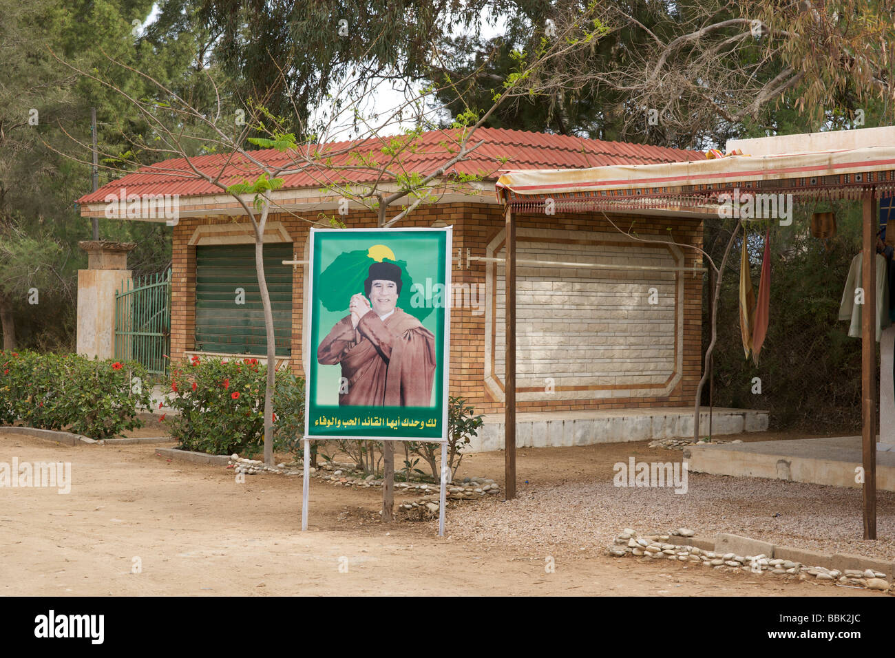 Poster of Colonel Gaddafi at Leptis Magna in Libya - Stock Image