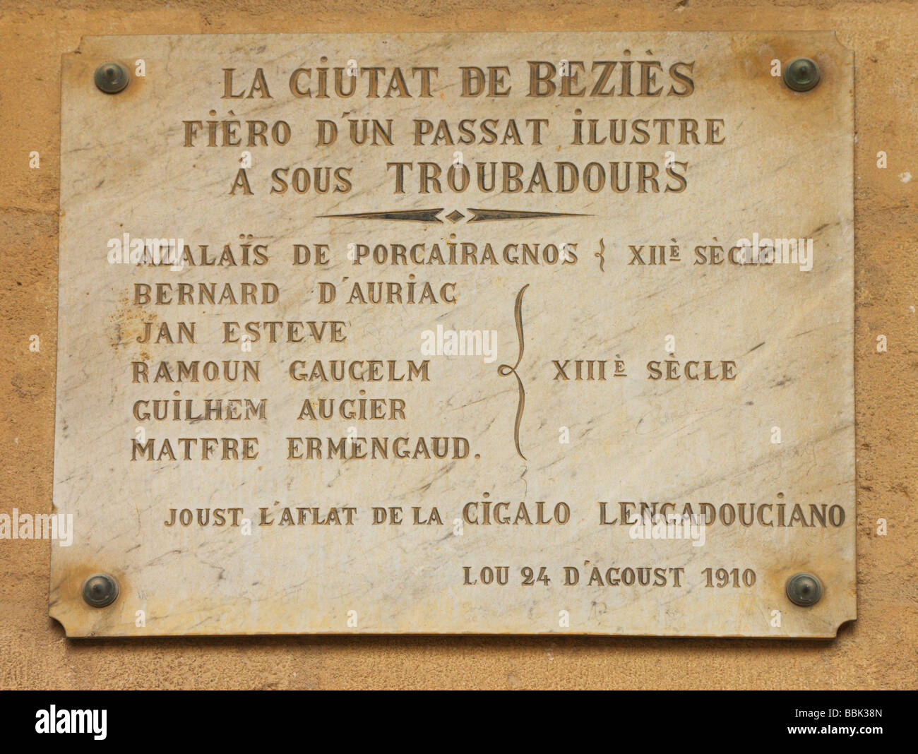 Plaque to commemorate medieval troubadours Saint Nazaire Cathedral Beziers Herault Languedoc-Roussillon France - Stock Image