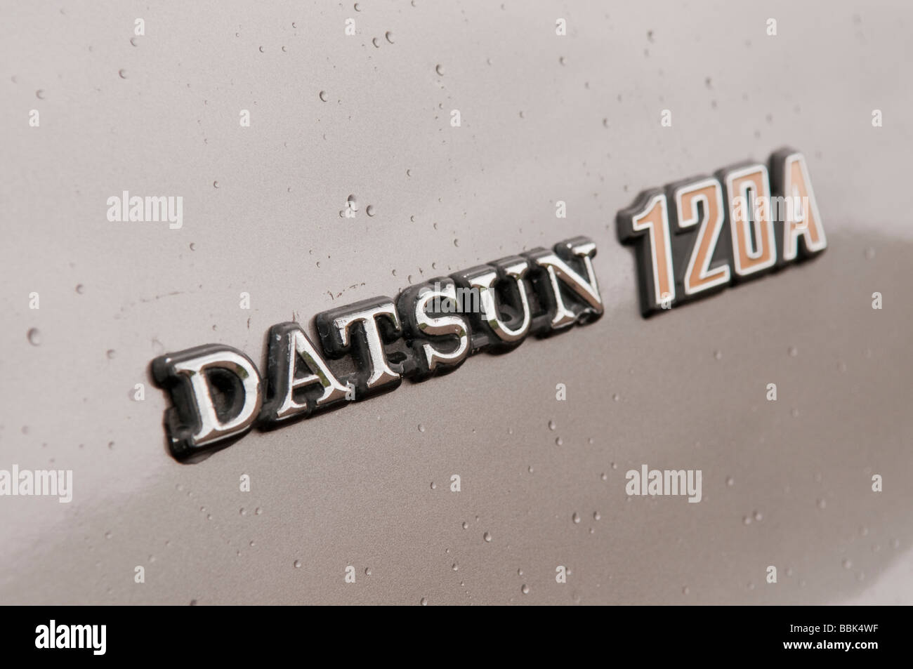 Badge on side of a first generation (E10) Datsun 120A, produced from 1970-1977 - Stock Image