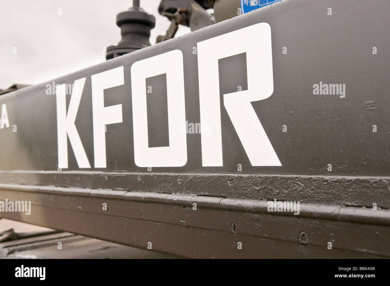 KFOR (Kosovo Force) on the side of a British Army Sabre tank - Stock Image