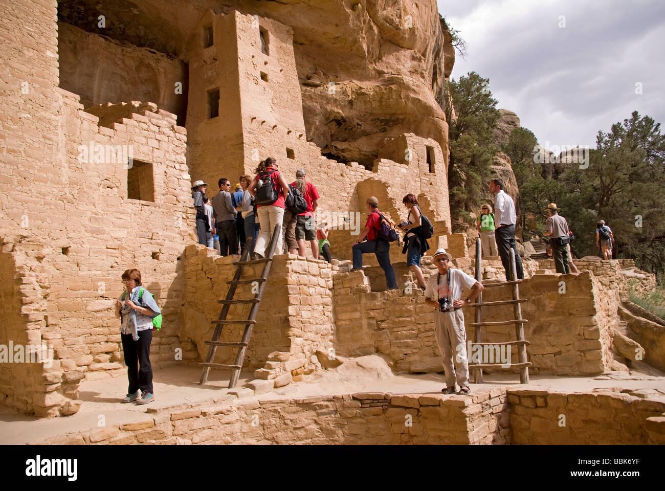 367f5120 USA Colorado Cortez Mesa Verde National Park Cliff Palace Ranger leads tour  through 12 century ancestral puebloan cliff dwelling