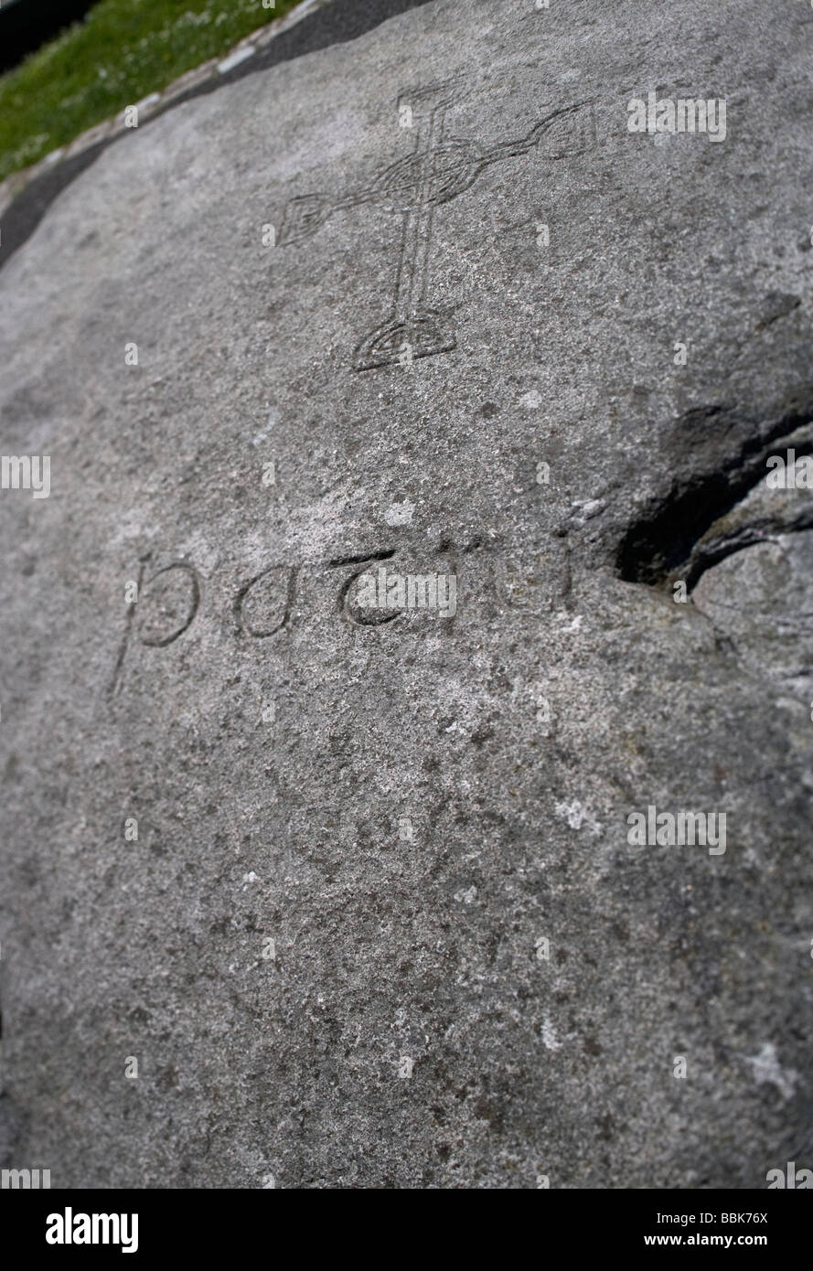 inscribed granite stone marking the supposed grave and burial site of st patrick in the grounds of down cathedral - Stock Image