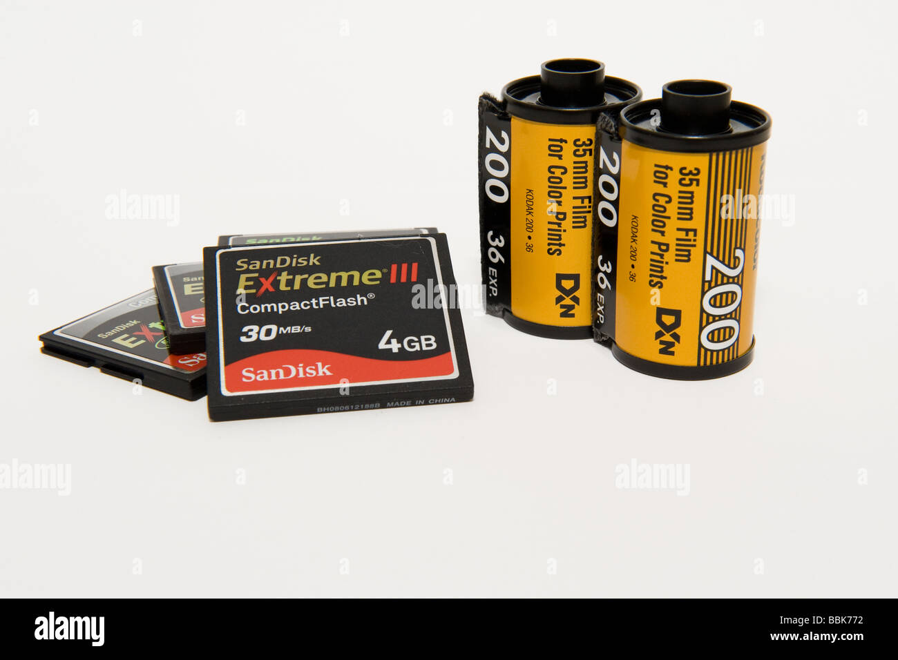 New generation high speed memory cards (CF) and 'old fashioned' 35mm film canisters/boxes. - Stock Image