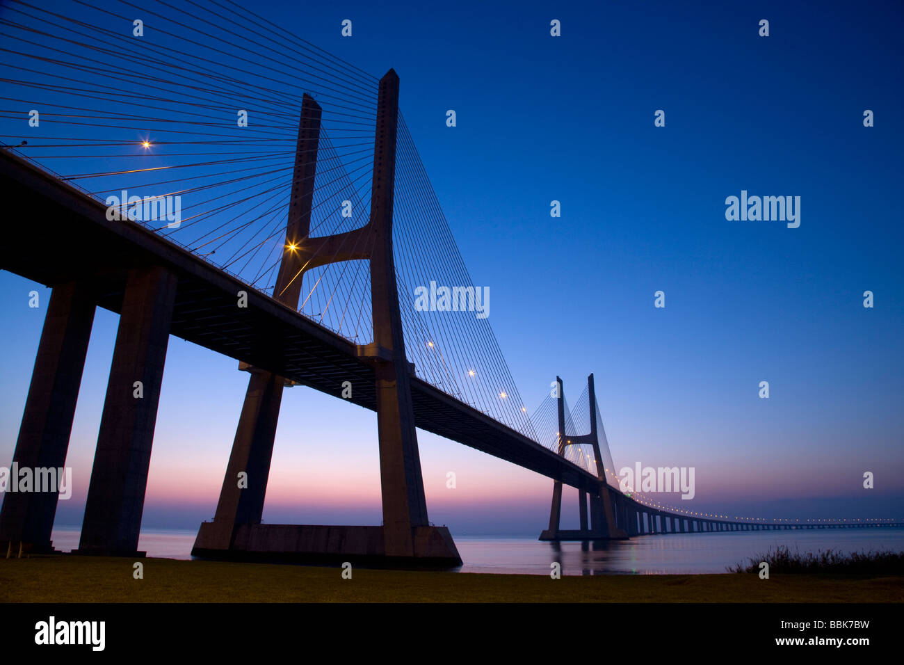 Vasco de Gama suspension bridge at night, Lisbon, Portugal, Europe - Stock Image