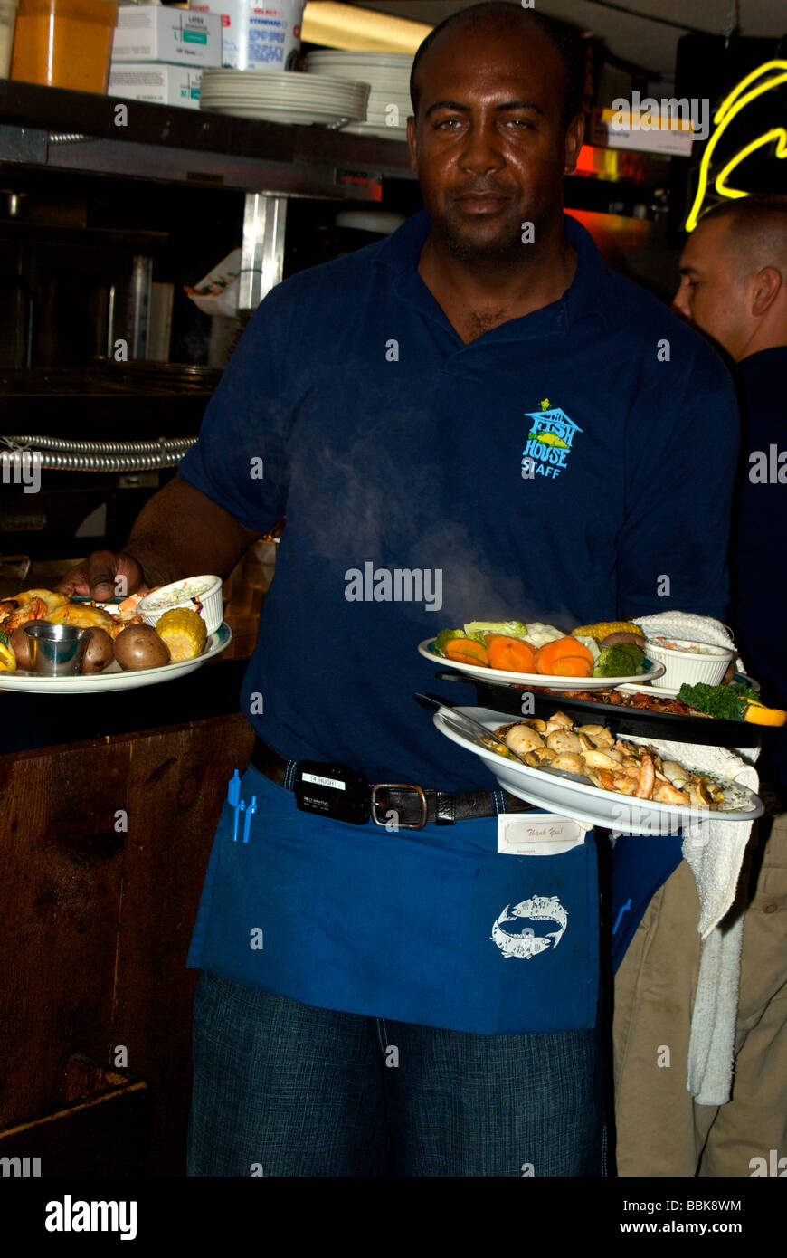Skilled waiter at the famed Fish House Restaurant in Key ...
