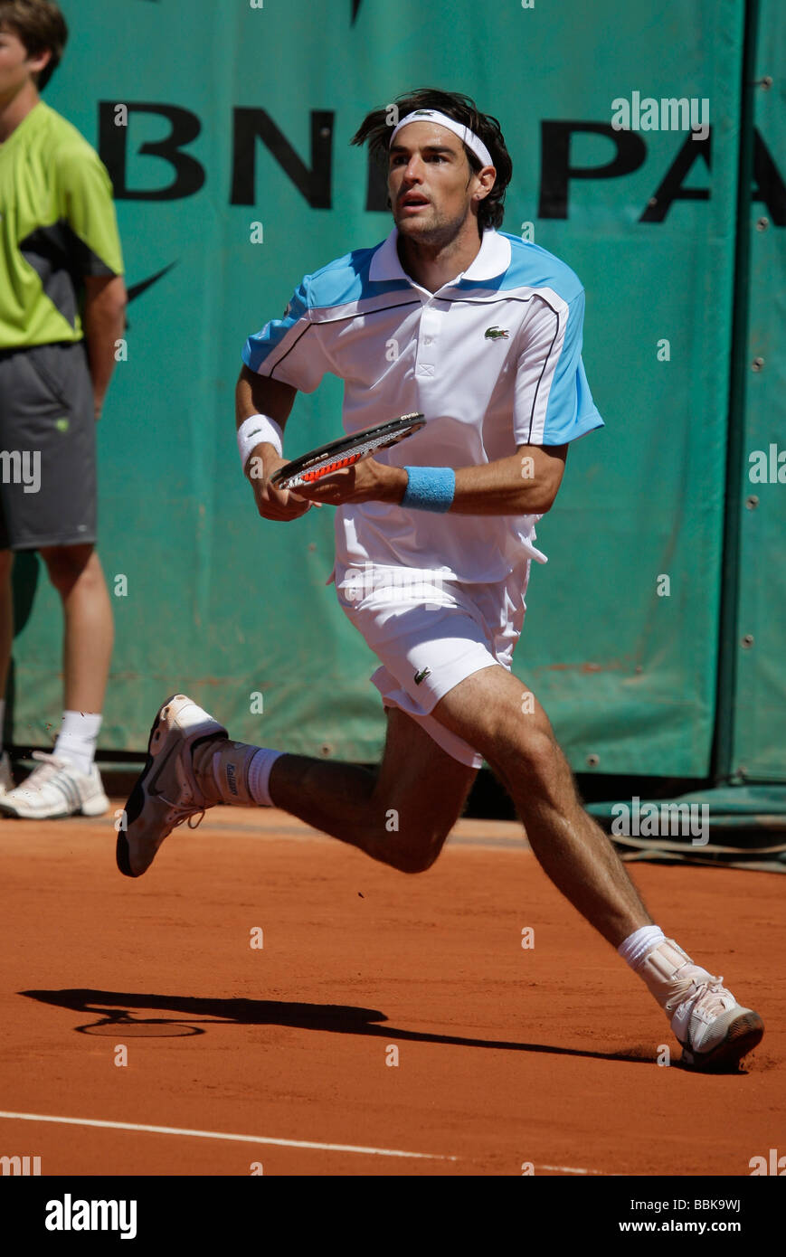 French player Jeremy Chardy(FRA )is running to play a backhand return at Roland Garros - Stock Image