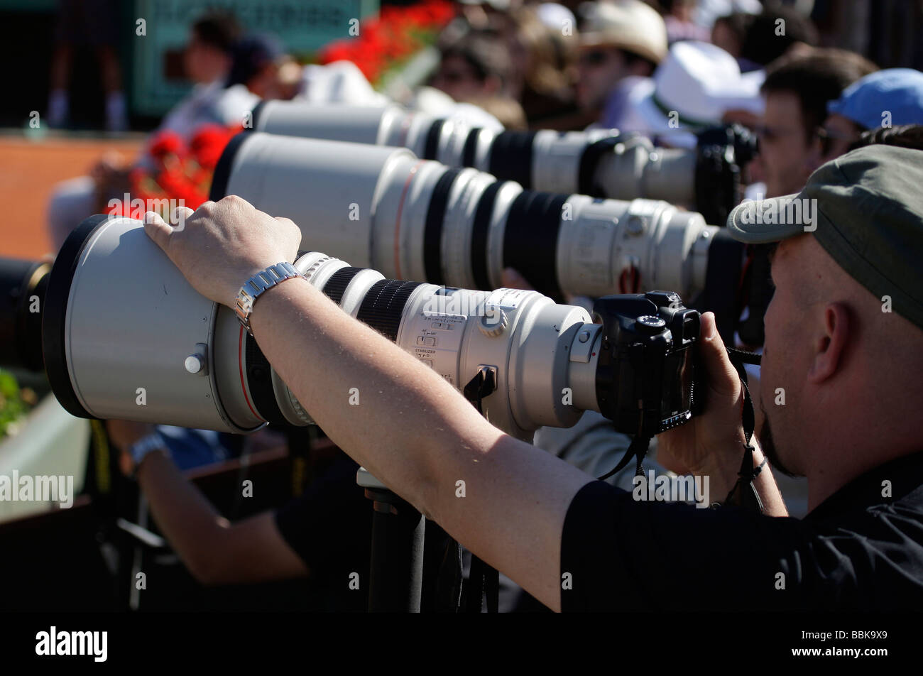 Row of photographers with telescopic lenses at the French Open Stock Photo