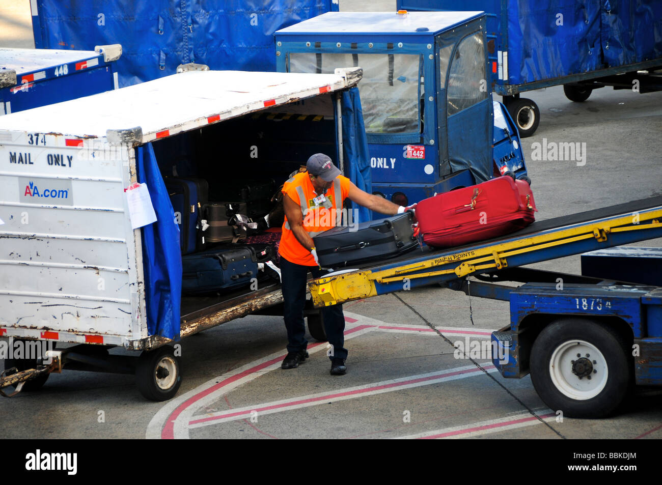 Airport baggage handler, Logan Airport, Boston, USA - Stock Image