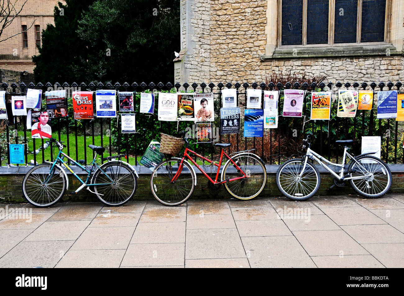 Bikes chained to raliings at Cambridge University, England - Stock Image