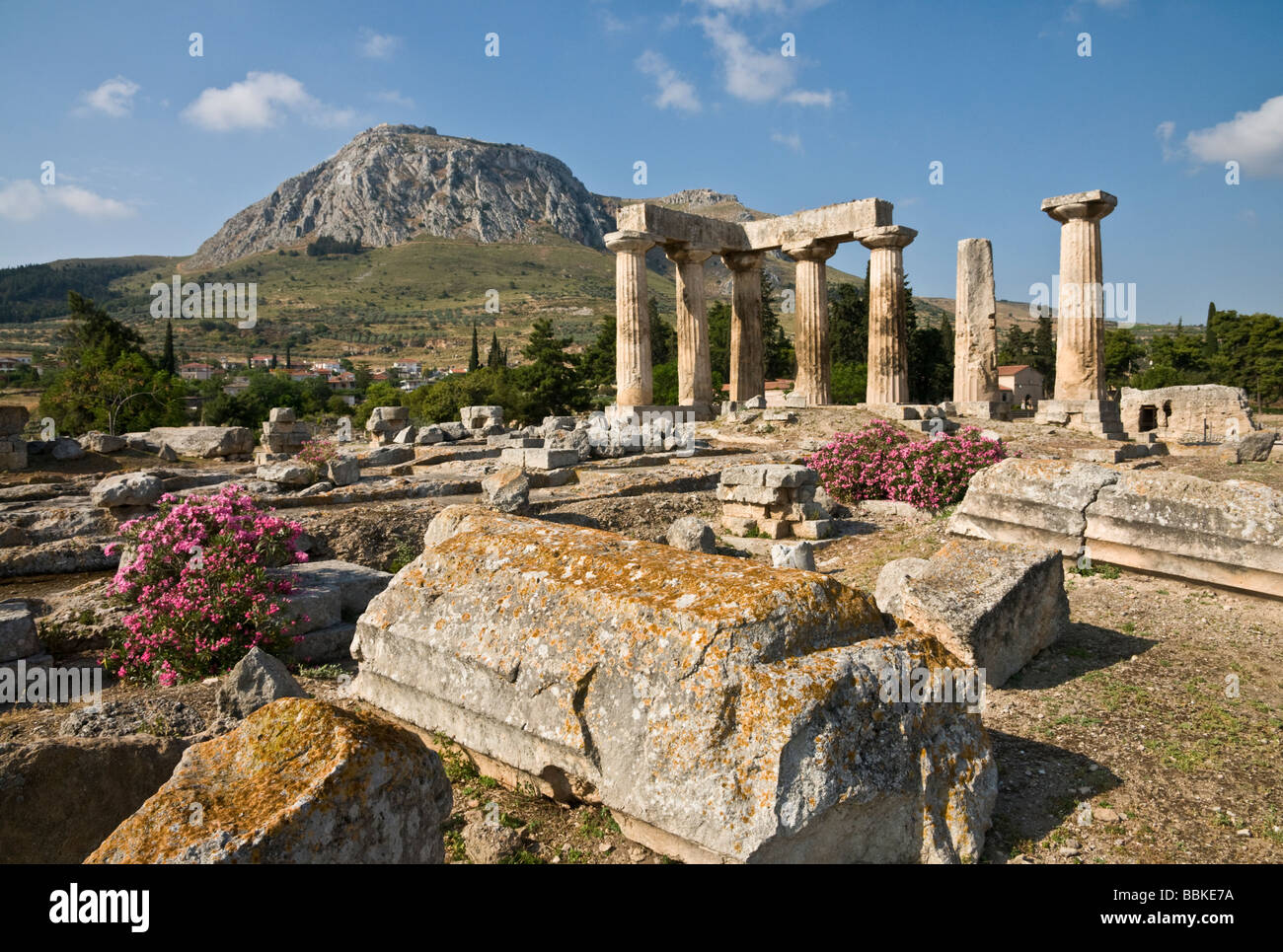 Looking across the 5th cen BC site of the Temple of Apollo at Ancient Corinth, Peloponnese, Greece - Stock Image