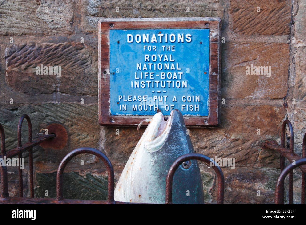 Royal National Lifeboat institution donation box in Robin Hoods Bay in North yorkshire, England, UK - Stock Image