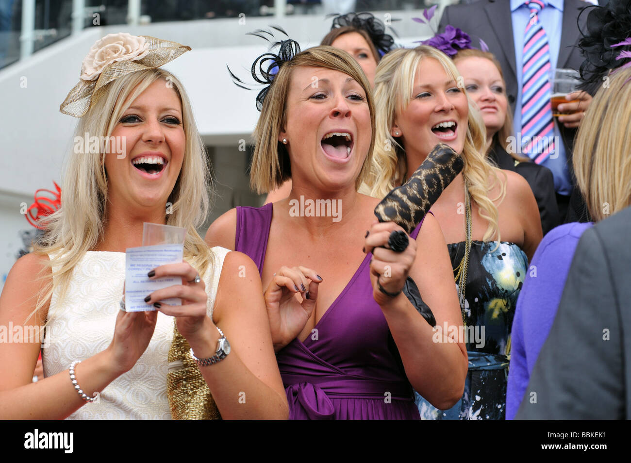 Two women race goers cheering their horse on Ladies day Epsom Races 2009 - Stock Image
