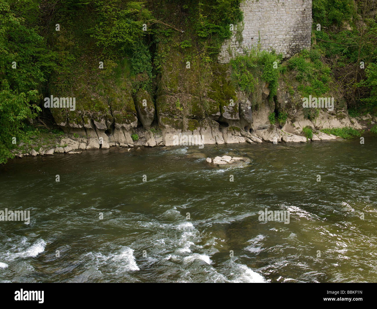 The bank of the Ourthe river shows very clear erosion patterns typical of wear by fast flowing water Durbuy Belgium Stock Photo